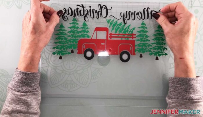 Layering the Holiday Truck vinyl to make a customized serving tray