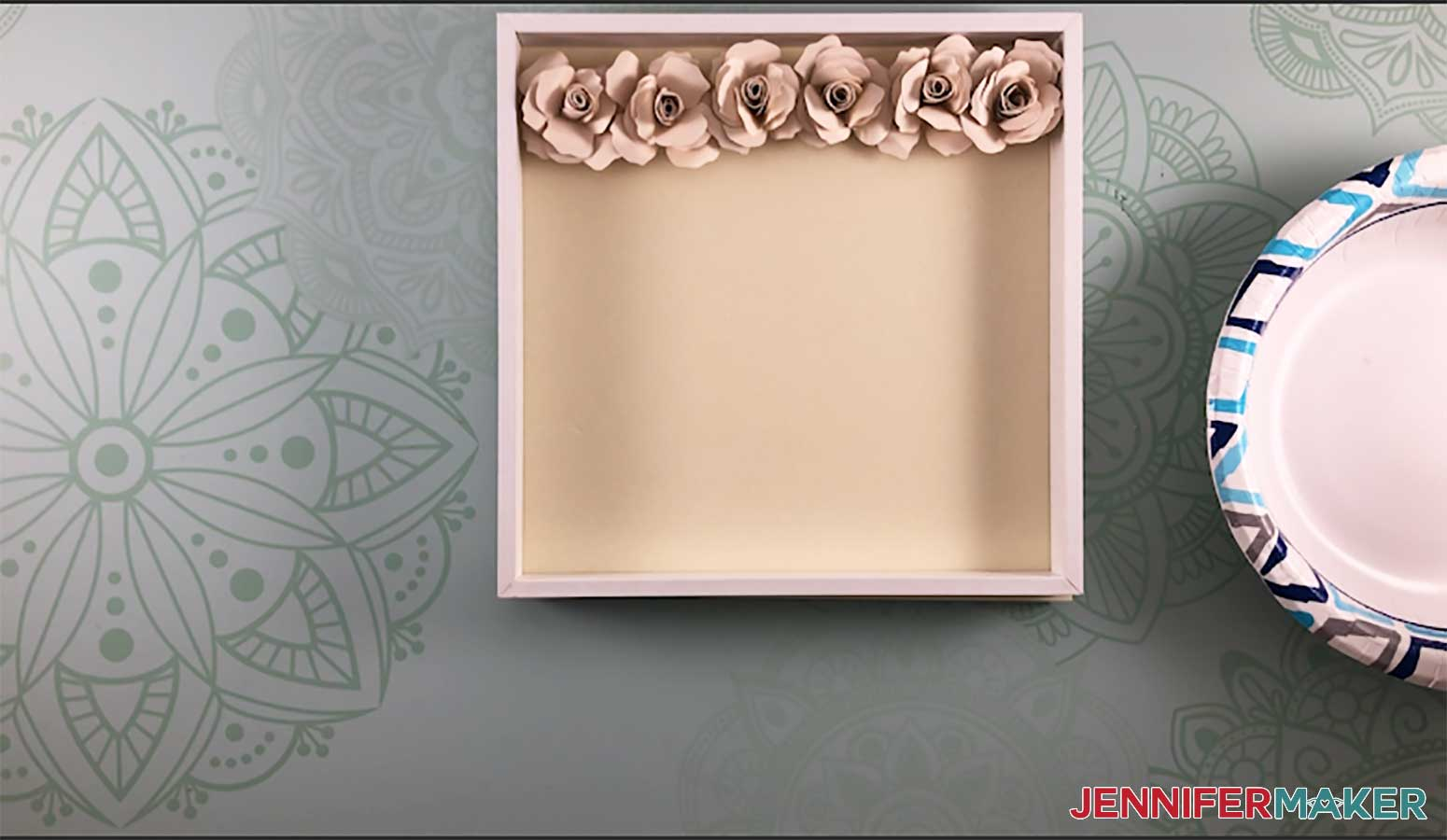 Arrange paper roses to make a paper flower shadow box