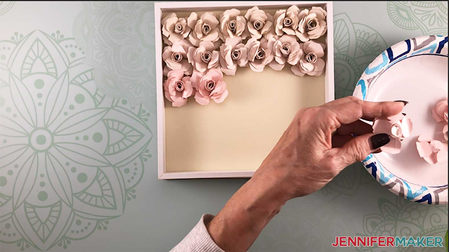 Filling up the shadow box with paper flowers