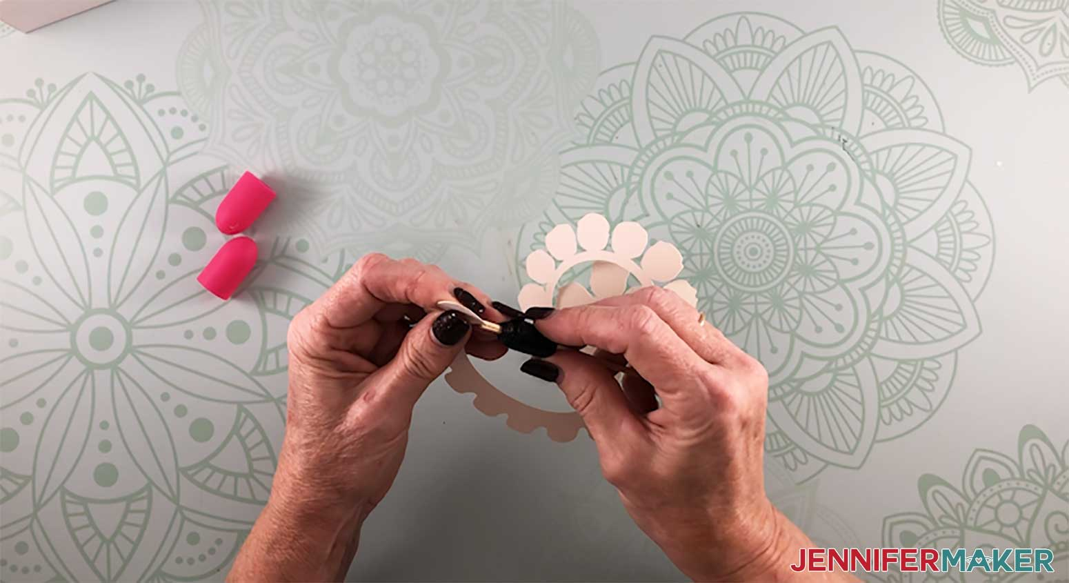 Rolling a paper rose with a DIY quilling tool to make a paper flower shadow box