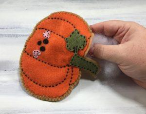 Stuffing the felt pumpkin