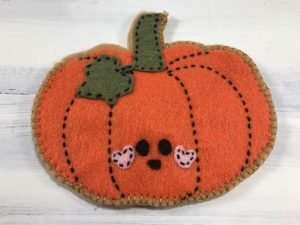 The felt pumpkin is sewed except for the last couple of inches