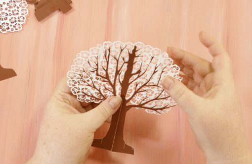Glue the branches and stick on the largest foliage for your apple tree pop-up