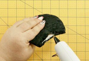 Glue the fabric closed over the foam ear