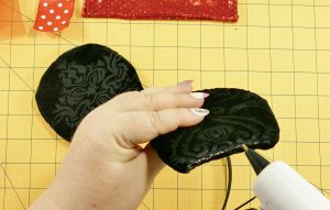 Glue the bottom of the mouse ear