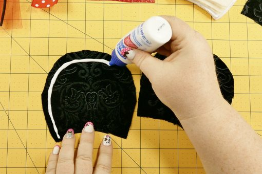 Place Liquid Stitch along the big curve of the fabric piece.