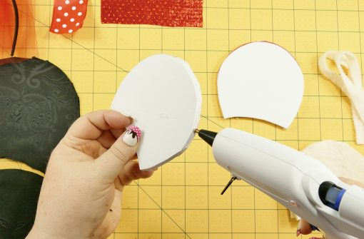 Put hot glue along the outer edge of the foam mouse ear