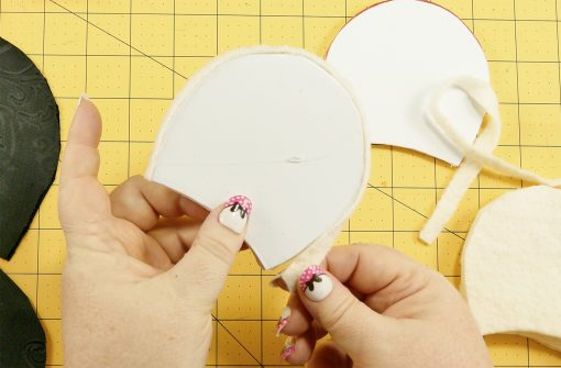 Attach the batting strip to the outer edge of the foam mouse ear