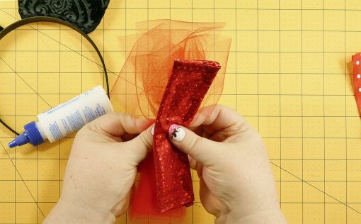 Add some tulle to the bow on the DIY Mouse Ears