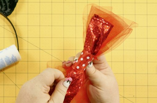 Wrap the ribbon around the bow and tulle on the DIY Mouse Ears