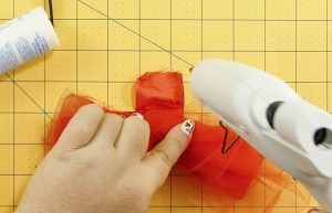 Glue the ribbon to itself on the DIY Mouse Ears