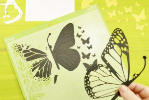 Removing the cut pieces for the DIY Pop Up Butterfly Card