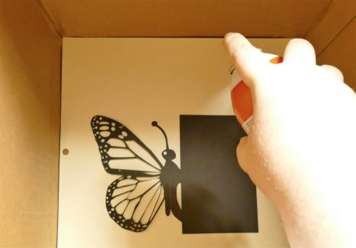 Spray adhesive on the butterfly wings for the pop up butterfly card