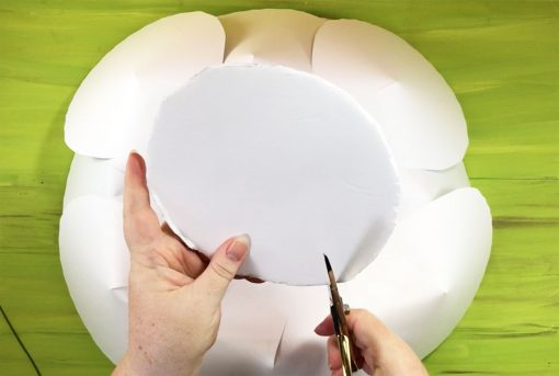 Attaching a foam and wire hanger to the back of the giant paper peony flower