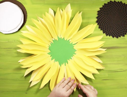 Attach petals to your paper sunflower