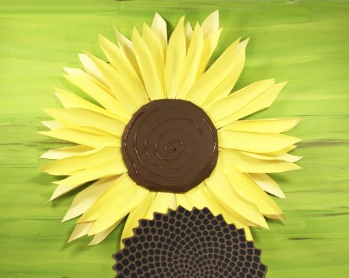 Putting the seed head on the paper sunflower