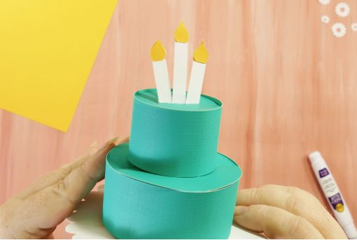 Glue the candles to the top of your pop-up birthday card cake
