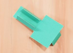 Fold the support of the pop-up birthday cake card