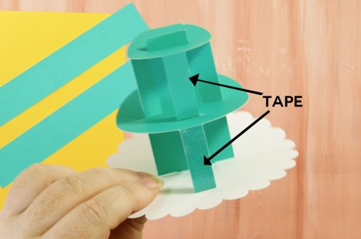 Put double-stick tape on the sides of your cake supoorts