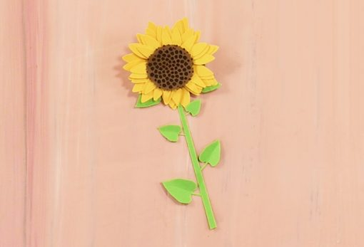 A finished rolled paper sunflower