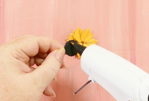 Gluing the seed head to the rolled paper sunflower