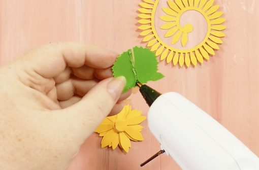 Glue the back of the sepal on your rolled paper sunflower