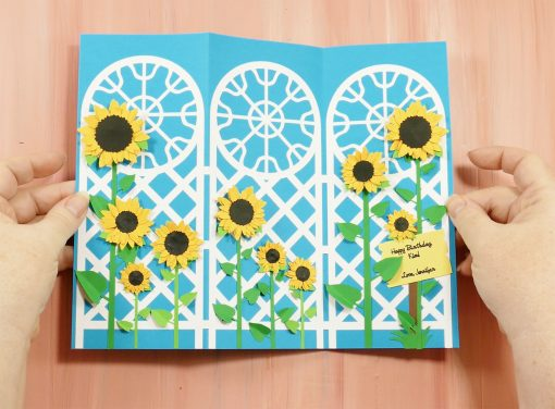 A decorated trellis tri-fold card