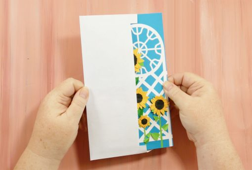 The trellis tri-fold card fits into a standard #10 envelope