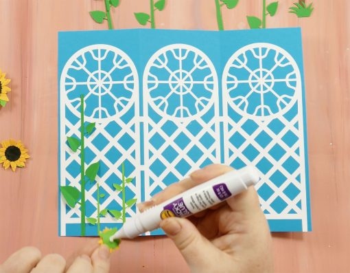 Glue the flowers onto the trellis tri-fold card