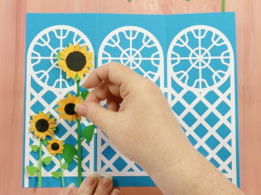 Place flowers on the trellis tri-fold card