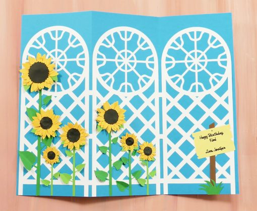 Put decorations on the trellis tri-fold card