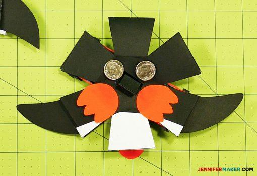 Glue dimes to the bottom of your penguin paper bomb to stabilize his pop ups