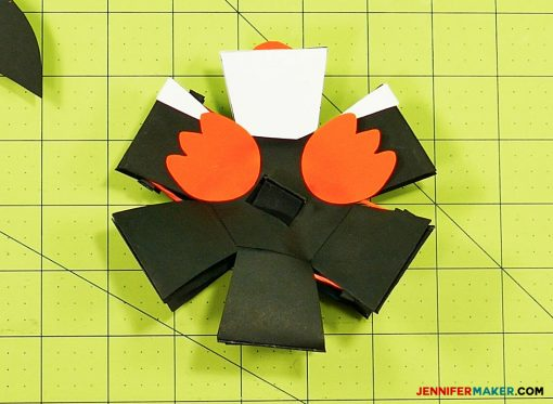 Glue the feet on your penguin paper bomb