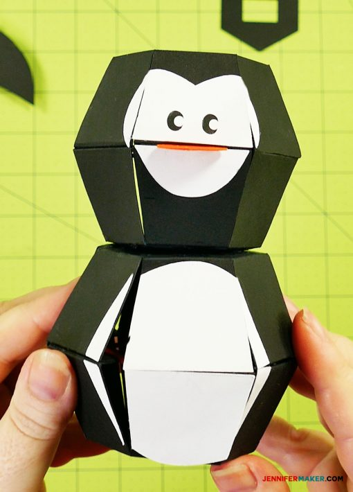Gluing the head to the body of your penguin paper bomb
