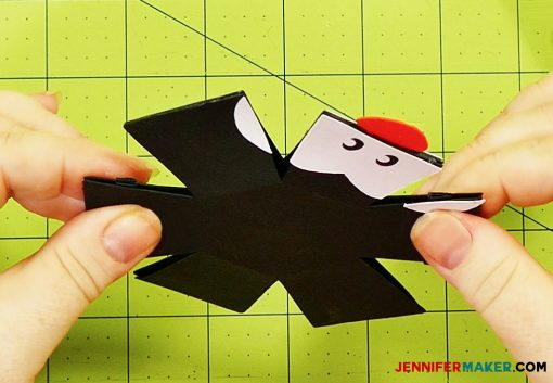 Attach the head together for the penguin paper bomb