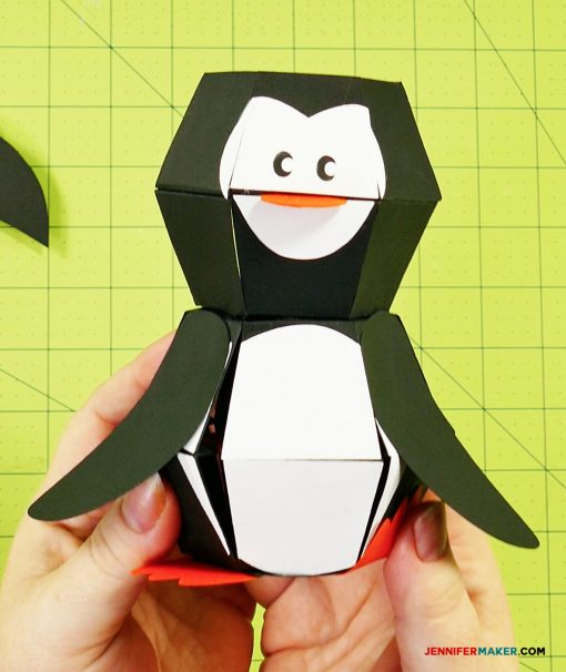 Glue the wings on your penguin paper bomb