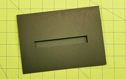 Fold the black card in half for the pop-up game controller card