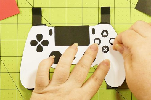 Attach the labels on the buttons of the the pop-up section of the pop-up game controller card