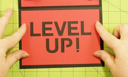 Attach the Level Up! Card to the pop-up game controller card
