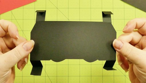 Fold the tabs on the black pop-up section for the popup game controller card