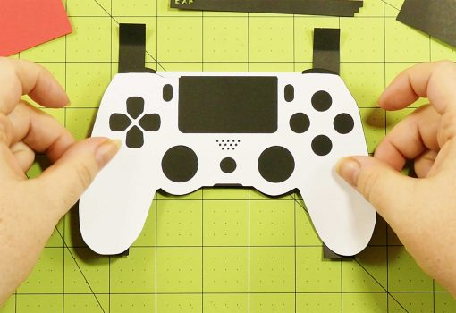 Attach the controller to the pop-up section of the pop-up game controller card