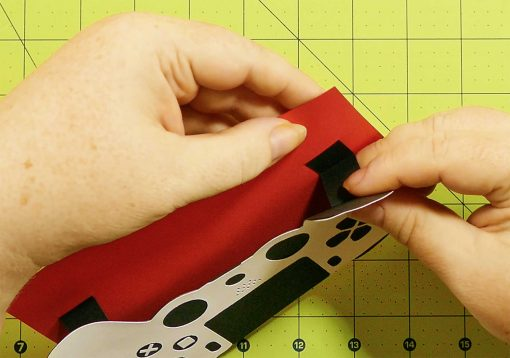 Insert the tabs into the slots for the pop-up game controller card
