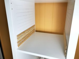 Placing the moulding on the inside the paper storage unit