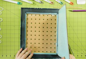 Open up the back of the frame with the pegboard in place
