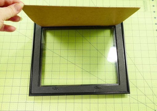 Remove the glass and cardboard from the frame