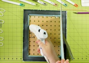 Glue the pegboard to the frame