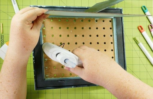 Glue the pegs at the back of the pegboard