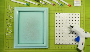 Materials to make a framed pegboard craft organizer