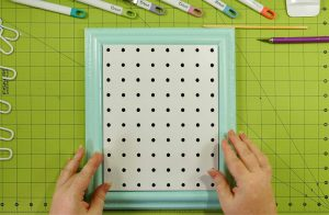 Place your pegboard on your frame