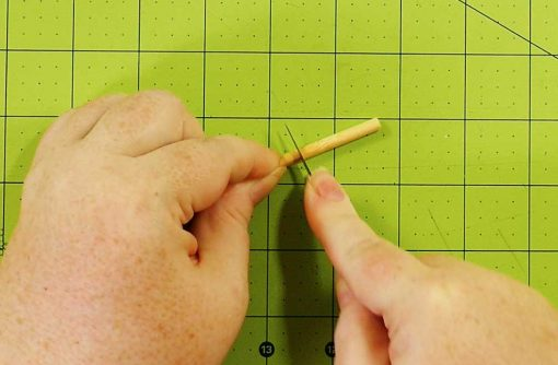 Cut off a piece of dowel or chopstick to make a peg